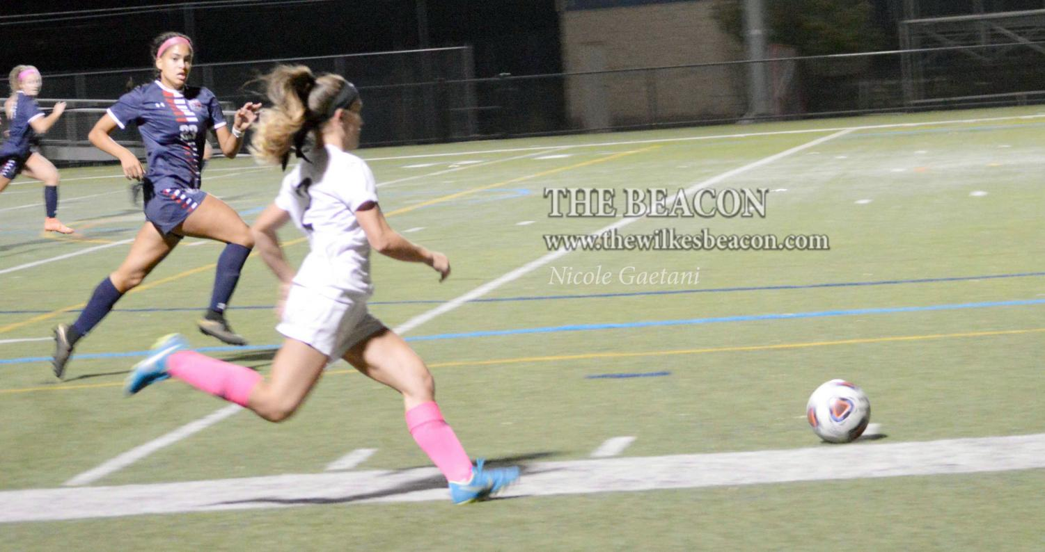 Senior Nicolette Towlen races down the sideline with the ball during the MAC Freedom semifinal game.