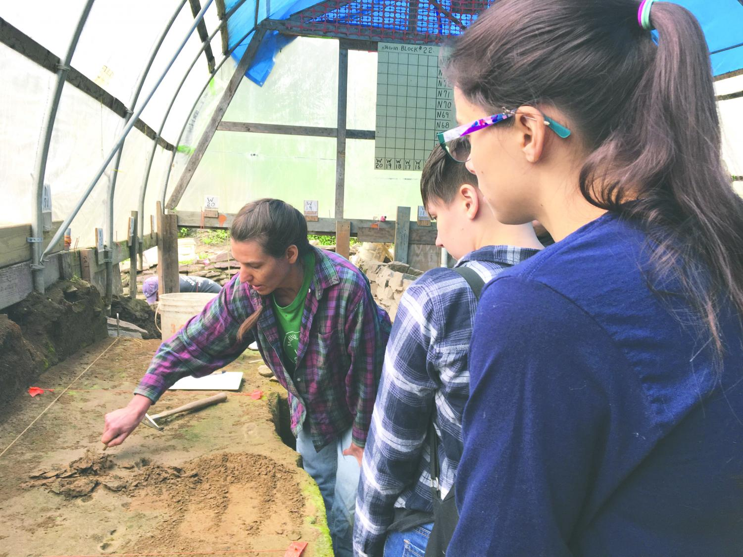 Eileen Blaine and Cece Hornbaker look to learn the methodology of excavation.