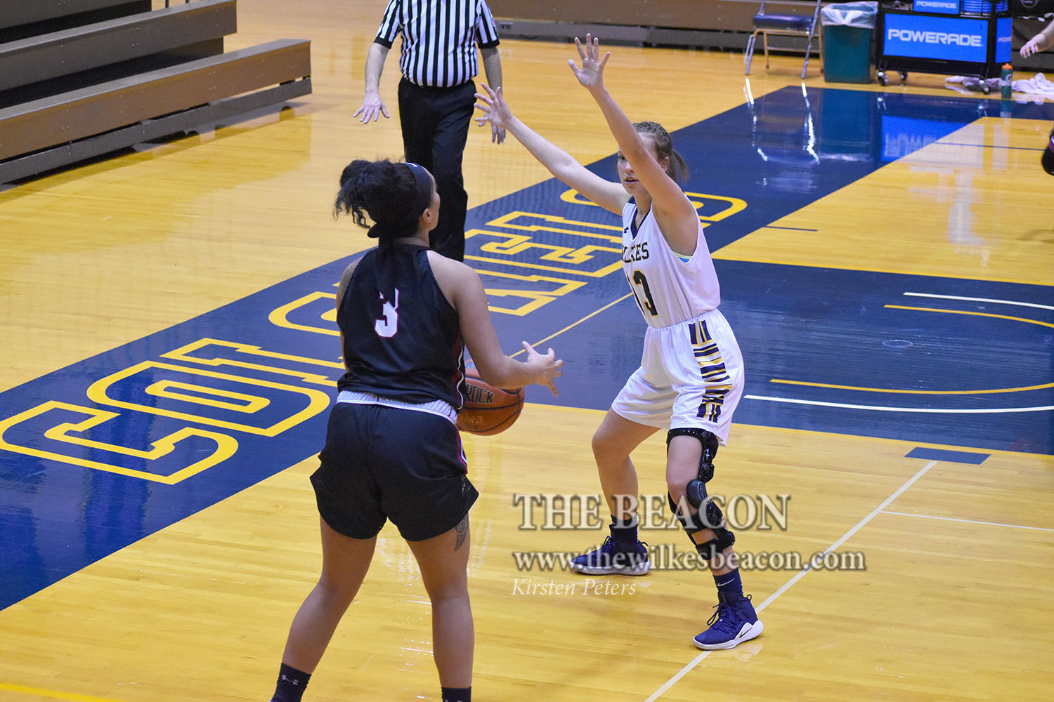 Sophomore forward Gabby Smicherko, who contributed 12 points, seven rebounds and three steals, defends Manhattanville's Ali Mikaele who looks to take a shot from the corner.
