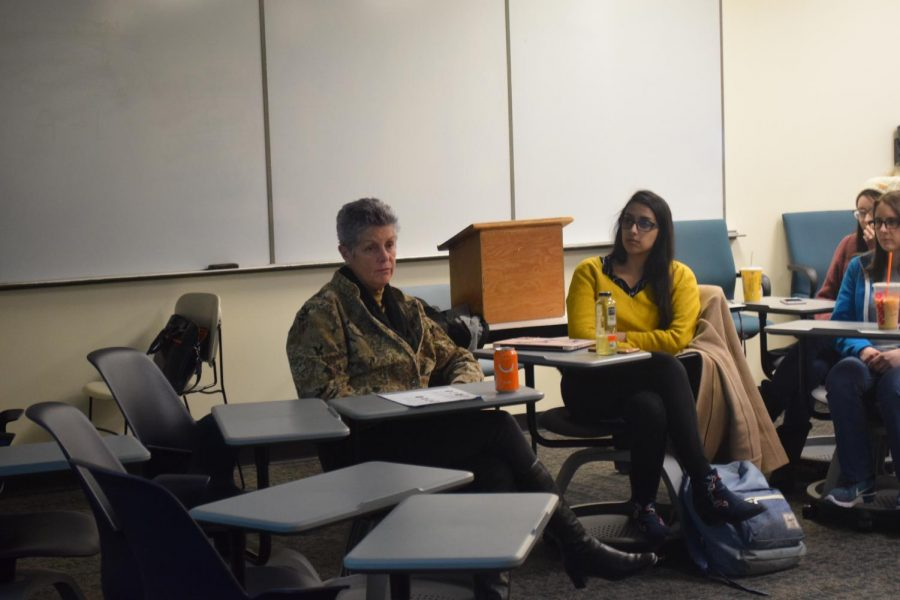 Students and faculty who attended the addiction lecture sat together with clinical social worker Beth Ann Delaney as she facilitated discussion.