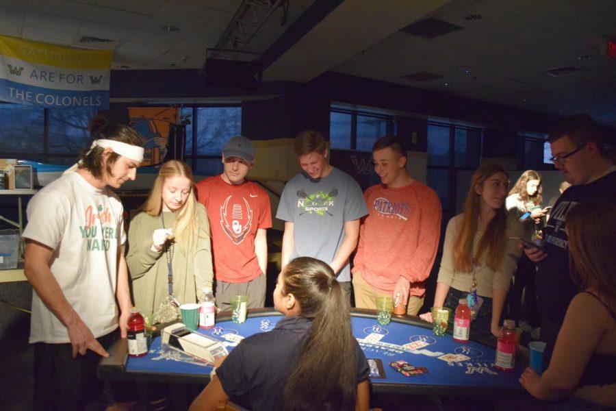Students play blackjack at Casino Night. From left to right: freshman Josh Brown, nursing; sophomore Victoria Bilski, nursing; freshman Joey Verespey, pharmacy; freshman Bryce Yencha, pharmacy; freshman Joseph Carey, pharmacy; freshman Jennifer Gronsky, pharmacy.