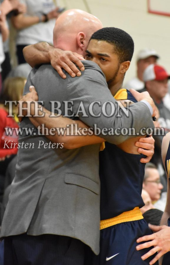 Wilkes+head+coach+Izzi+Metz+embraces+distraught+senior+guard+Marcus+Robinson+after+losing+in+his+last+chance+at+a+conference+title.