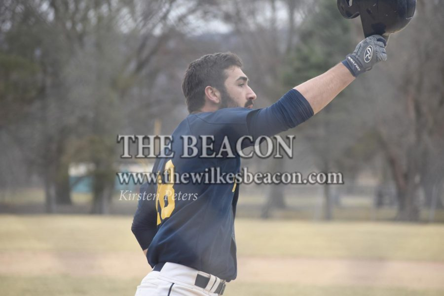 Senior+Nicholas+Capozzi+tapping+helmets+after+hitting+a+home+run+against+Eastern%2C+one+of+his+two+in+a+week+where+he+went+.545+on+11+at+bats.