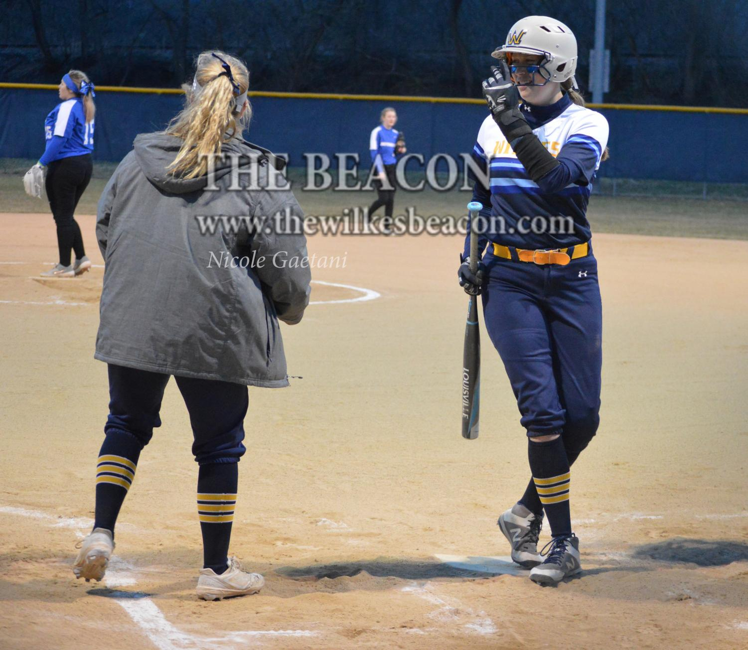 Senior outfielder Haley Welker signaled to her teammates with a smile on her face during the doubleheader against Clarks Summit last Wednesday.