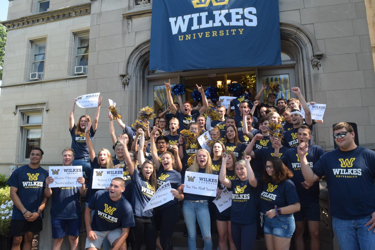 Wilkes+University+sports+teams+and+Marching+Colonels+pose+for+a+photo+in+front+of+the+new+athletics+logo.+