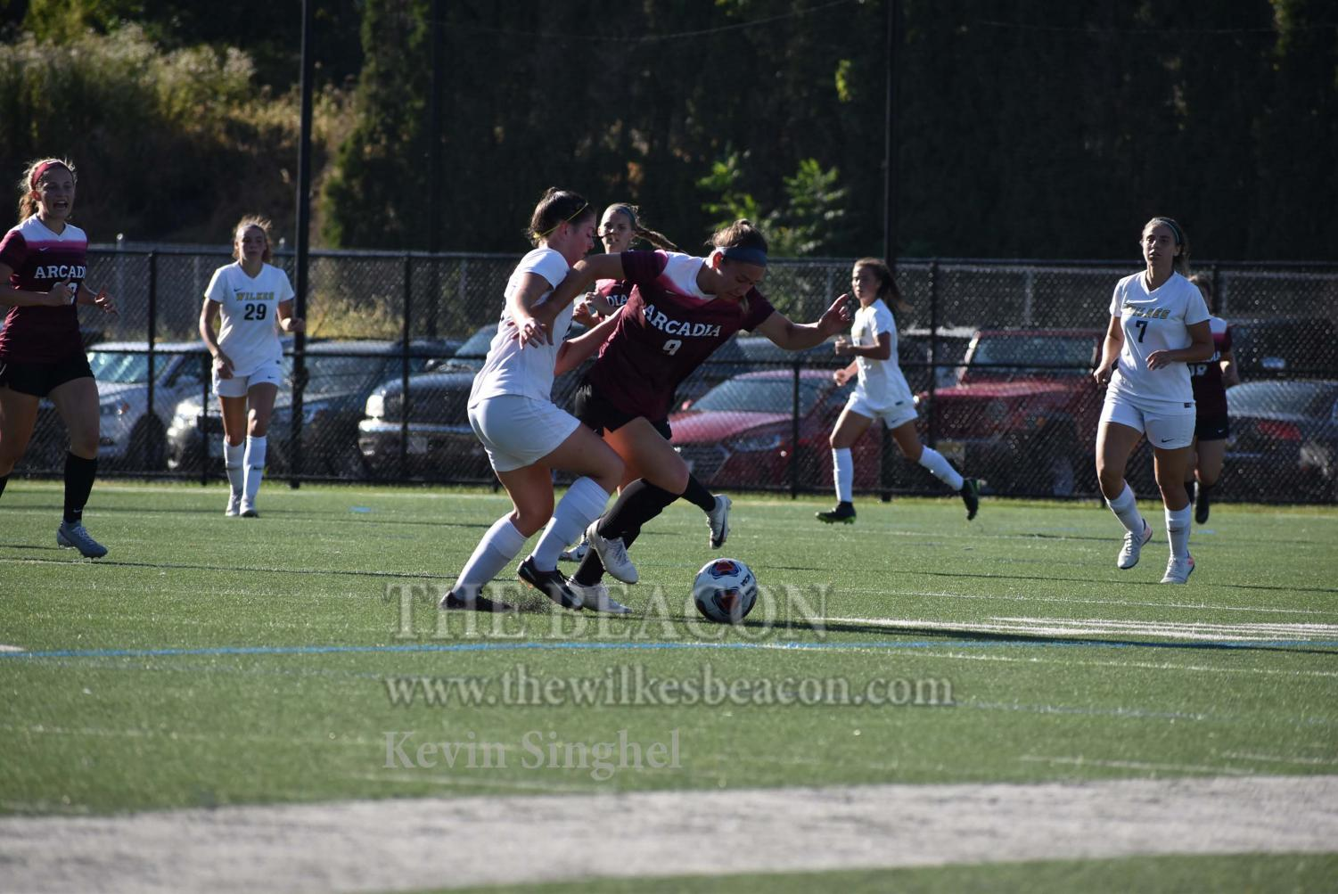 Junior defender Catherine Gregoire attempts to stop Arcadia's push up the field in Saturday's contest against the nationally-ranked opponent.