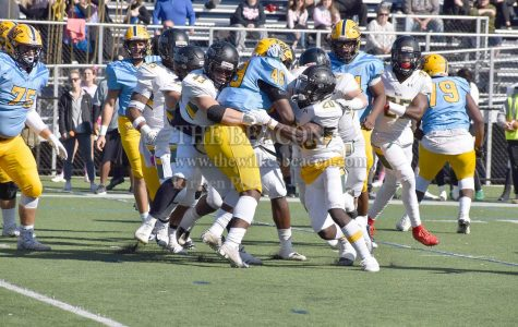Sophomore fullback Jeremiah Acker was held by a swarm of Aggie defenders in a moment that depicts the tone of the game with Wilkes being trumped by Del Val.