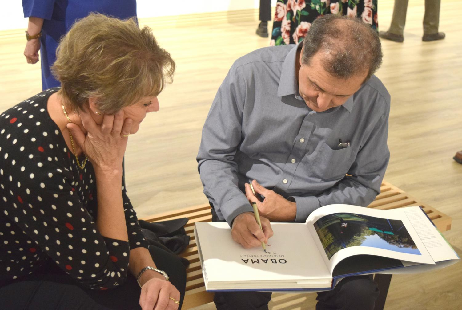 """Jean Adams, pottery/ceramics instructor for Wilkes University, has her copy of """"Obama: An Intimate Portrait: The Historic Presidency in Photographs""""  signed by Pete Souza."""