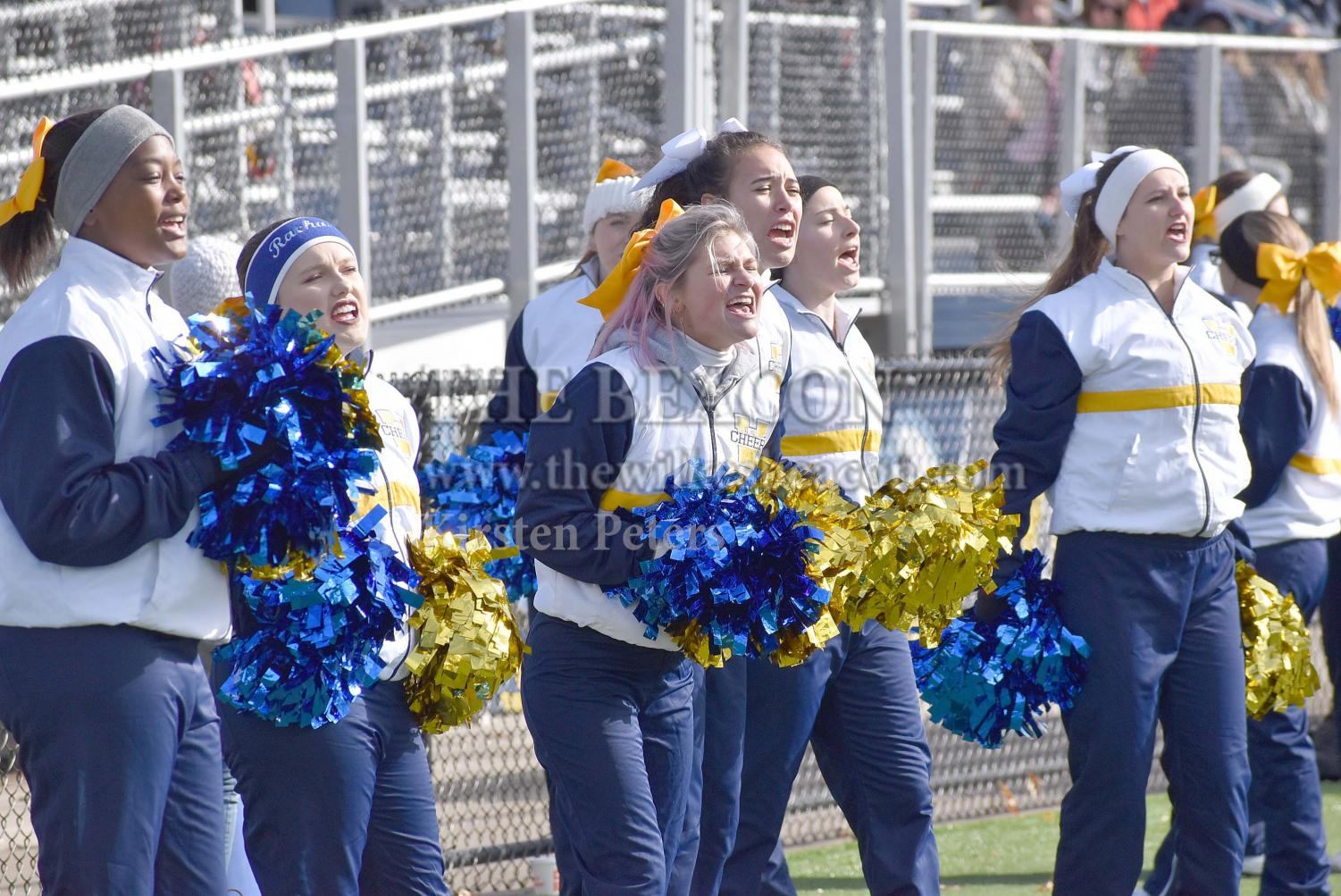 The Wilkes cheerleading team energizes the football team and fans during Wilkes' game against Stevenson on Saturday.