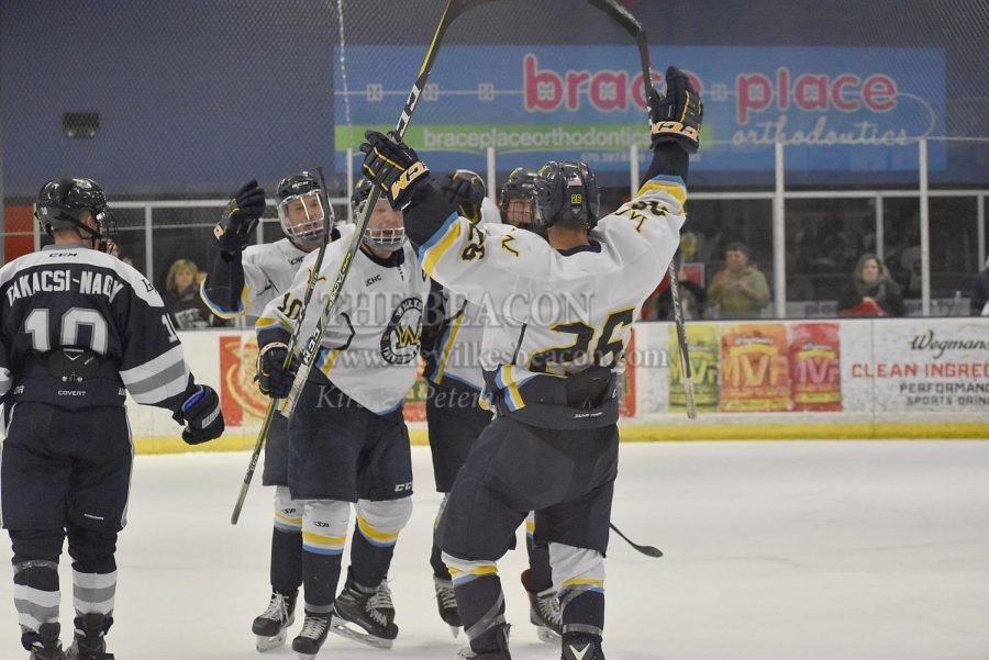 The+Colonels+celebrate+after+sophomore+forward+Joey+Pasquini+%28No.+26%29+scores+his+first+collegiate+goal+to+tie+the+game+at+3-3+in+the+third+period.
