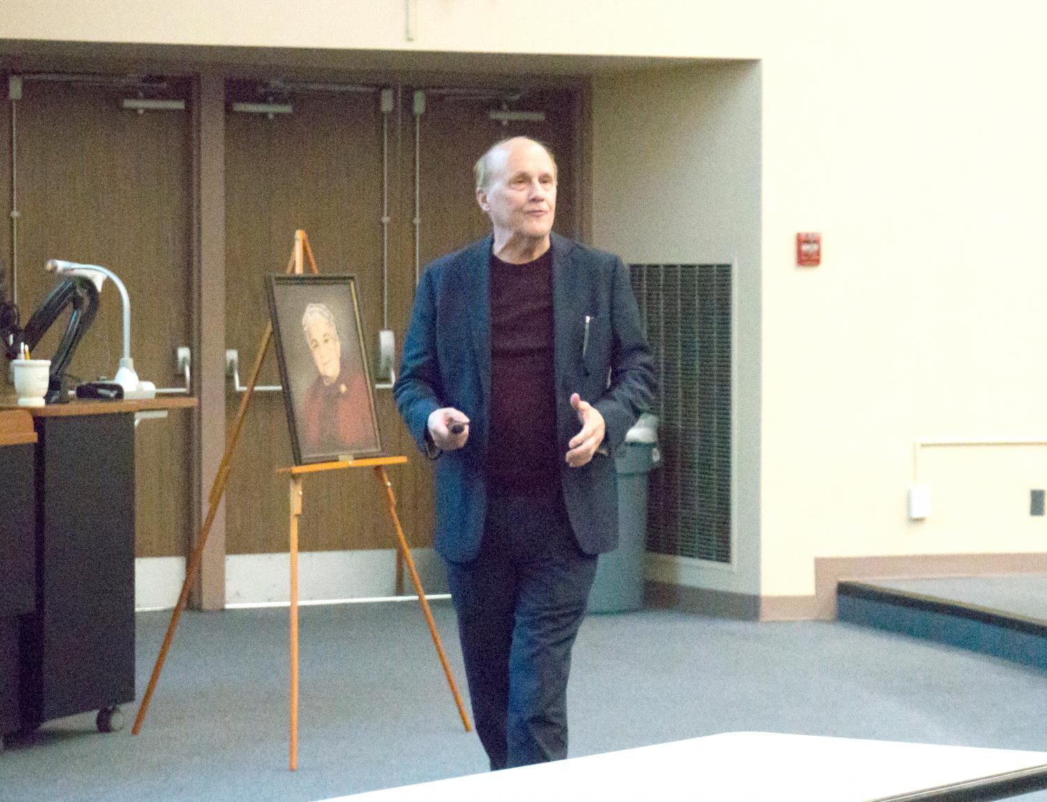 Pownall speaks about his research efforts, Catherine Bone is pictured behind him.