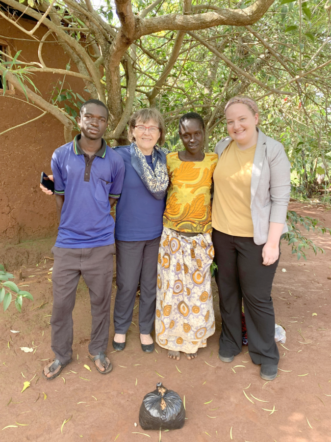Winkler+and+Plumhoff+pose+alongside+their+friend+Alimwenda+and+her+son+Mjuni+in+Tanzania.