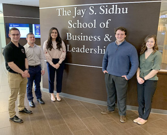 From left to right, Edward Lukowski, Nick Schepis, Taylor Akmal, Garret Gagliardi and Kacee Diehl, all student volunteers with the VITA Program.