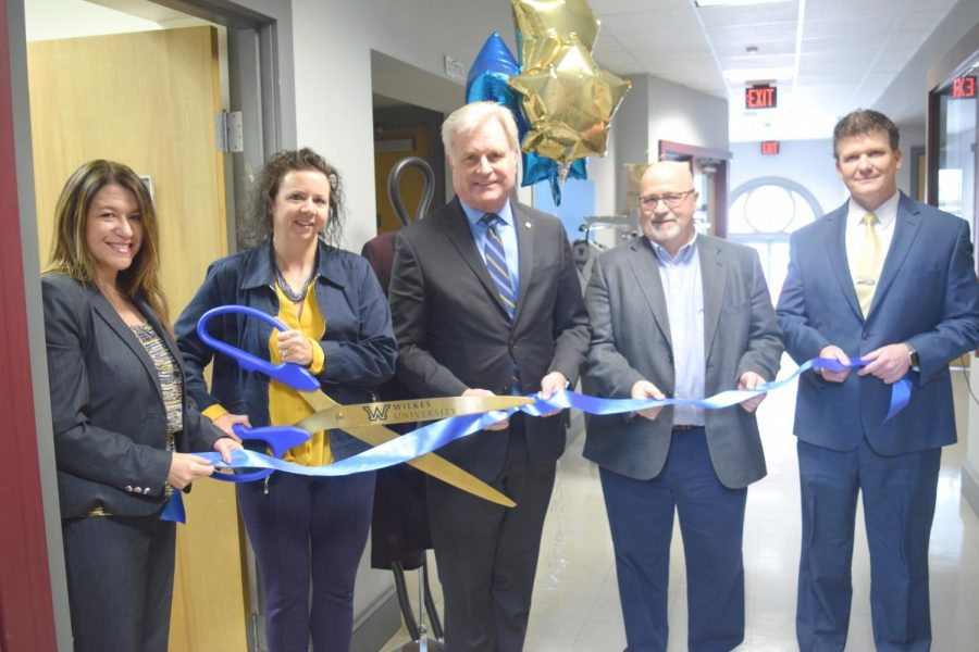Sharon Castano, director of student development; Lisa Mulvey, coordinator for career development and internships; Interim President Dr. Paul Adams; Mark Allen, vice president of student affairs and Phil Ruthkowsky, associate dean of student development at the ribbon cutting ceremony for the Colonel Clothing Closet.