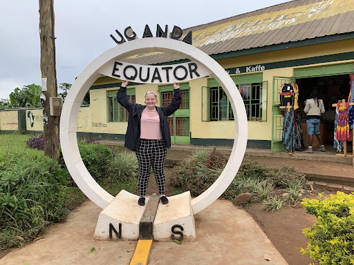 Plumhoff poses at a sign marking the Equator, which runs through the far south of Uganda.