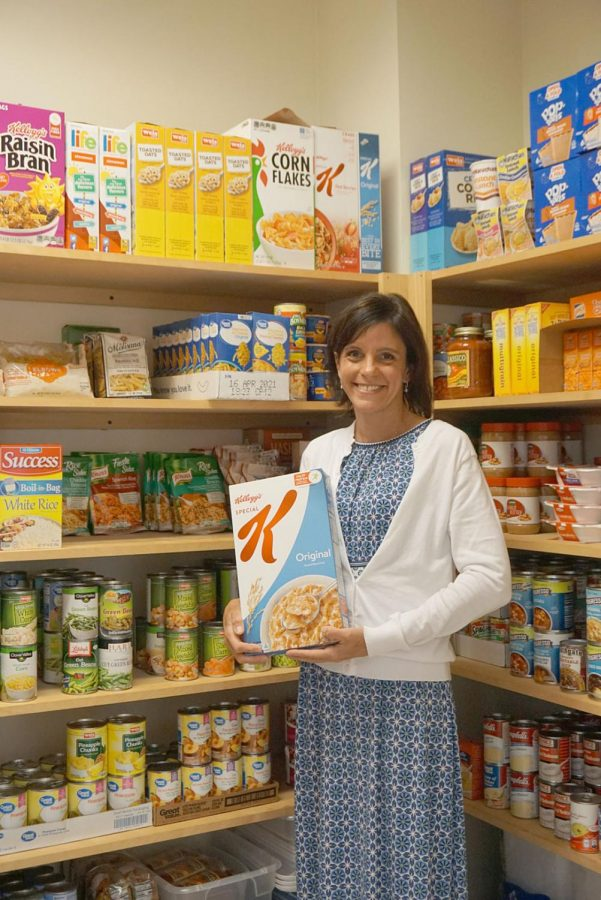 Kristin Osipower, campus interfaith coordinator, pictured in front of the Colonel's Closet food pantry.