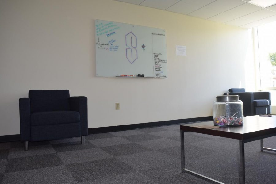The new honors lounge has socially-distanced furniture for students, as well as a white board for students to share messages.