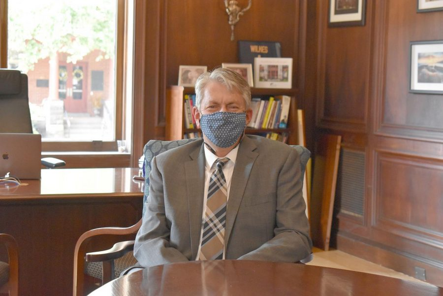 Dr. Greg Cant prepares to welcome the Wilkes community back to campus in his mask.