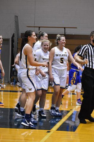The Colonels celebrate after guard Kendra Smith (center) scored in the paint.